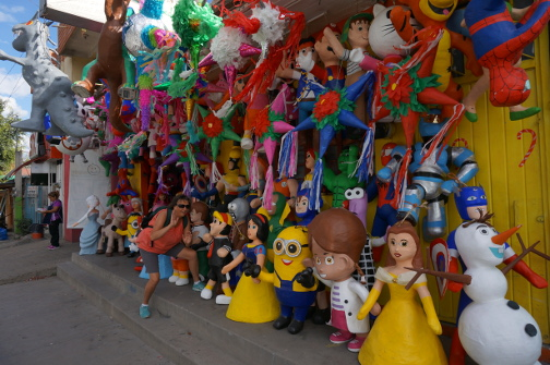 A store full of fanciful figurines and pinatas -- a visual treat.